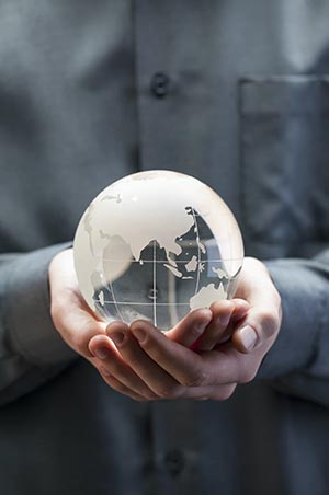 globe of earth being held in cupped hands